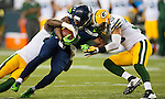 Seattle Seahawks wide receiver  Percy Harvin (11) is tackled by Green Bay Packers safety Morgan Burnett, left, and defensive back Micah Hyde (33) in the NFL Kickoff Game game at CenturyLink Field in Seattle, Washington on September 4, 2014. Harvin caught seven passes for 59 yards, rushed for 41 and returned three kickoffs for 60 yards. The Seahawks pounded the packers 36-16. ©2014  Jim Bryant Photo. ALL RIGHTS RESERVED.