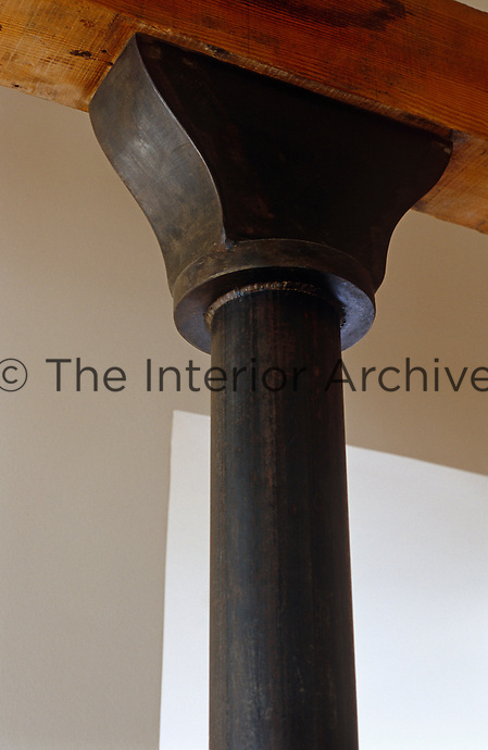 Detail of an oxidized steel supporting pillar and capital