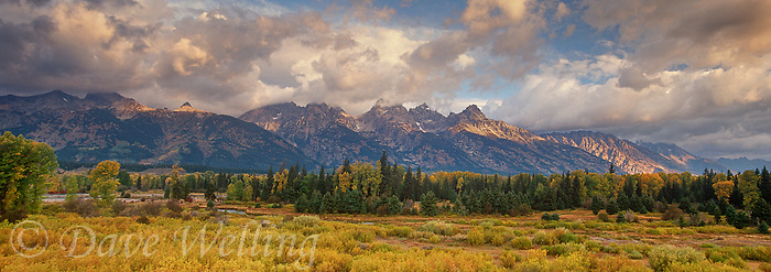 937000018 panoramic view clouds from a clearing storm frame portions of the teton range with fall colored grasses in the foreground from blacktail ponds grand tetons national park wyoming
