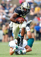 WEST LAFAYETTE, IN - SEPTEMBER 15:  Quarterback Austin Parker #17 of the Purdue Boilermakers runs away from defensive lineman Pat O'Connor #52 of the Eastern Michigan Eagles at Ross-Ade Stadium on September 15, 2012 in West Lafayette, Indiana. (Photo by Michael Hickey/Getty Images)***Local Caption***Austin Parker; Pat O'Connor