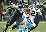 Seattle Seahawks defensive tackle Jarran Reed (90) lunges to tackle Carolina Panthers running back Jonathan Stewart (28) at CenturyLink Field in Seattle, Washington on December 4, 2016.  Seahawks beat the Panthers 40-7.  ©2016. Jim Bryant photo. All Rights Reserved.