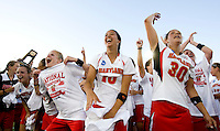 Alex Aust (10), Danielle Kirk (30) and teammates celebrate with the crowd after winning the NCAA Championship held in Johnny Unitas Stadium at Towson University in Towson, MD.  Maryland defeated Northwestern, 13-11, to win the title.