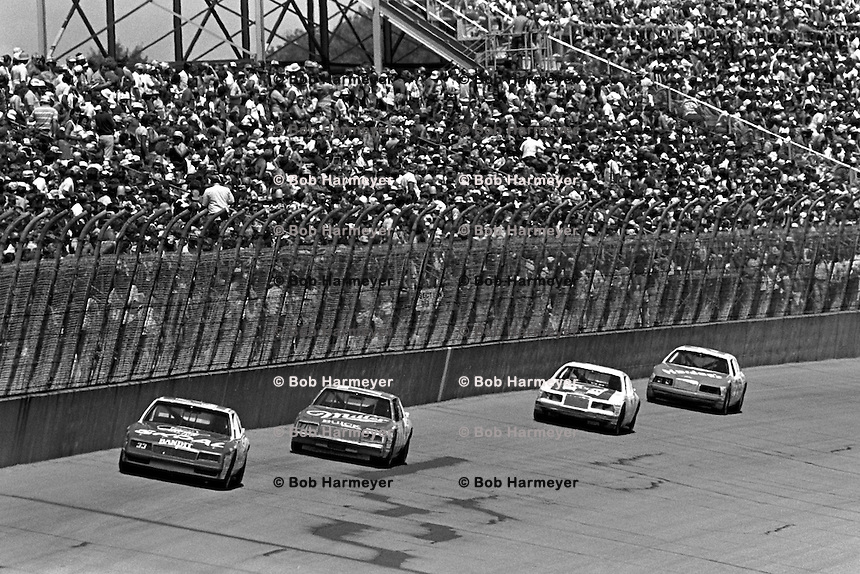 BROOKLYN, MI - AUGUST 11: Harry Gant drives his Hal Needham Chevrolet in front of Greg Sacks, Kyle Petty and Cale Yarborough during the Champion Spark Plug 400 NASCAR Winston Cup race at the Michigan International Speedway near Brooklyn, Michigan, on August 11, 1985.