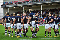 Scotland players celebrate at the final whistle. Rugby World Cup Pool B match between Scotland and Japan on September 23, 2015 at Kingsholm Stadium in Gloucester, England. Photo by: Patrick Khachfe / Onside Images