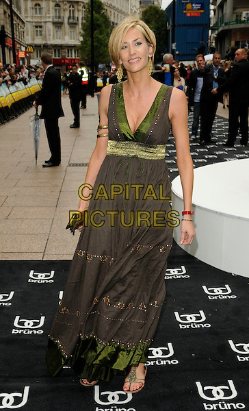 LISA BUTCHER.UK film premiere of 'Bruno', at Empire Leicester Square, London, England..June 17th, 2009  .full length dress green gold long maxi sleeveless brown .CAP/CAN.©Can Nguyen/Capital Pictures.