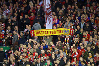 LIVERPOOL, ENGLAND - Thursday, October 4, 2012: Liverpool's supporters on the Spion Kop with a 'Justice For The 96' banner before the UEFA Europa League Group A match against Udinese Calcio at Anfield. (Pic by David Rawcliffe/Propaganda)