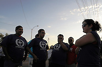 Phoenix, Arizona. June 23, 2012 - Members of the Unitarian Universalist church and community advocates gathered outside the Tent City Jail in Arizona to demand  Sheriff Joe Arpaio to shut down what they call a &quot;concentration camp&quot; and inhumane outdoor jail facility. Tent City houses inmates in canvas tents and during the summer the temperature raises significantly under the tents. In this image, activists of Puente Arizona including Sandra Castro (right) talk before the demonstration against Sheriff Joe Arpaio begins. Photo by Eduardo Barraza &copy; 2012