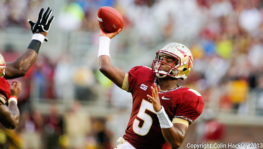 TALLAHASSEE, FLA 9/21/13-FSU-BCC092113CH-Florida State quarterback Jameis Winston throws against Bethune-Cookman during first half action Saturday at Doak Campbell Stadium in Tallahassee. <br /> COLIN HACKLEY PHOTO