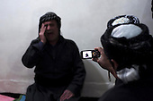 BIARA, IRAQ: A student films an Iranian dervish singing mystical Islamic songs during the celebration of Mullah Osman's birthday at the Biara Madrassa and Mosque...The Biara Madrassa--a religious school--is located high up in the mountainous Kurdish Hawraman region that makes up the Iran/Iraq border. Before 2003 the region was home to a fundamentalist Islamic group called Ansar al-Islam who used the school as a base. The Unites States military attacked the area and the madrassa numerous times during the 2003 invasion, finally pushing Ansar al-Islam out...Today the madrassa is home to 48 male students from all across Kurdish Iraq. The students leave their families and immerse themselves in their studies and the daily life of Koranic students...Photo by Besaran Tofiq