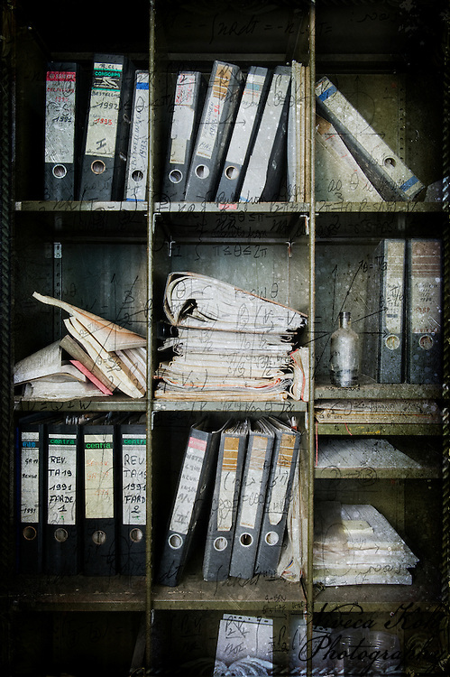 Files on shelves in abandoned Belgian powerplant