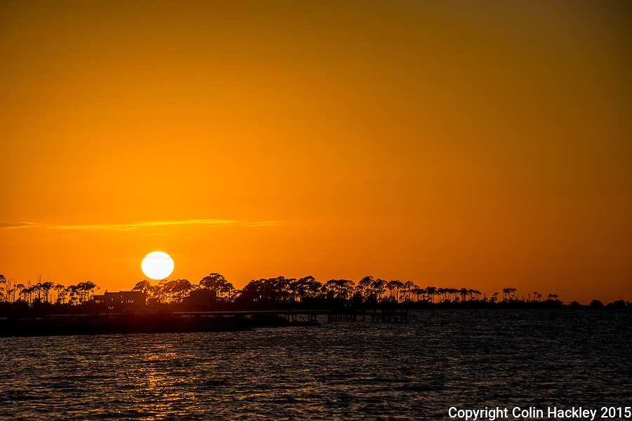 St. GEORGE ISLAND, FLA., 11/25/15- The sun sets over the western end of St. George Island, Fla. <br /> <br /> COLIN HACKLEY PHOTO