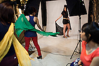 A group of models posing in photography studio.