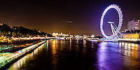View of the River Thames and London Eye in London, England at night.