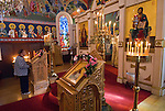 Liturgy service at St. Sava Orthodox Church, Jackson, Calif...An elderly woman during a moment of prayer before the liturgy starts.