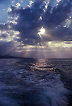 The sun shinning through a bank of cloud, over the Pacific ocean. Fiji Islands, August 1981.