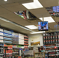 A monitor shows the video feed of security cameras in a store in New York on Tuesday, January 26, 2016. (©  Richard B. Levine)