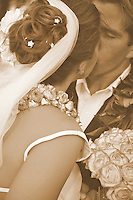 Sepia toned photo close up of bride and groom kissing