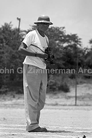 Cleveland Abbott (1892-1955), coach of the Tuskegee women's track and field program, filming a workout, Tuskegee, 1952.  Abbott also coached the Men's Football team at Tuskegee. CREDIT: © John G. Zimmerman Archive.