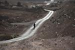 ISRAEL Negev desert<br /> A Bedouin woman walks on a road early morning.