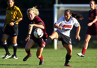 WINSTON-SALEM, NORTH CAROLINA - August 30, 2013:<br /> Charlyn Corral (9) of Louisville University kicks the ball away from Kelsey Loupee (9) of Virginia Tech during a match at the Wake Forest Invitational tournament at Wake Forest University on August 30. The game ended in a 1-1 tie.