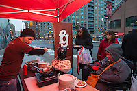 Chef Matt Basile of Fidel Gastro previews his dishes outside the St. lawrence market for early-comers  at FoodShare Toronto's Recipe for Change, February 28,  2013