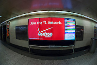 Verizon advertising in Penn Station in New York on Tuesday, May 12, 2015. Verizon Communications announced that it will acquire AOL for approximately $4.4 billion pending regulator approval. (© Richard B. Levine)