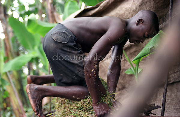A man making the traditional local beer in Goma, RDC..copyright : Magali Corouge/ Documentography
