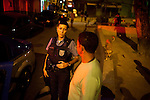 UPP officer Carla Bon talks with a resident during patrol in Complexo do Caju, Rio de Janeiro, Brazil, on Friday May 10, 2013.<br /> <br /> In the early hours of Sunday, March 3, 2013, about 1,400 Brazilian security forces occupied 13 communities during a joint public security operation to install a Pacifying Police Unit (UPP) in two Rio de Janeiro favelas, Complexo do Caju and Barreira do Vasco. Elite police units backed by armored military vehicles and helicopters invaded the neighborhood in an on-going policing program aimed to drive violent and heavily armed drug gangs out of Rio's poor communities, where the traffickers have ruled for decades. For the community of Caju, that is ADA (Amigos de Amigos) and CV (Comando Vermelho).