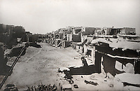 Oraibi, Arizona, possibly the oldest inhabited village in America, with classic Pueblo architecture with plaster over stone and a central plaza for religious and social gatherings and rooftops serving as upper patios reached by exterior stairs and ladders, photograph by Adam Clark Vroman, 1898, in the Anasazi Heritage Center, an archaeological museum of Native American pueblo and hunter-gatherer cultures, Dolores, Colorado, USA. Picture by Manuel Cohen
