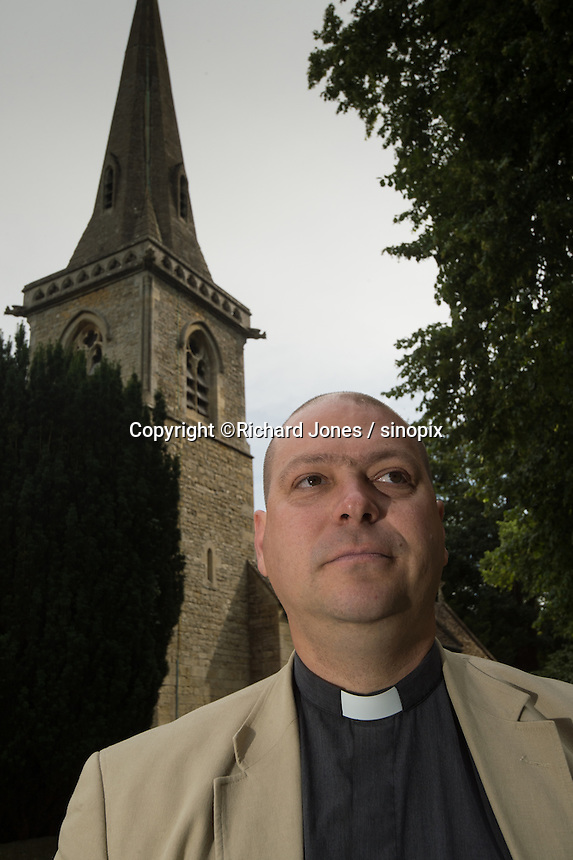 Rev. Nick Scott, of St Mary's Church in Lower Slaughter, Cotswolds, Gloucestershire, 19th July 2016. Chinese couples often use the church for wedding photos. An increasing number of Chinese couple are having their wedding photos taken in the English country-side, classic towns and monuments to show in China. <br /> <br /> Photo by Richard Jones/Sinopix
