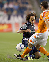 New England Revolution defender Kevin Alston (30) attempts to block Houston Dynamo pass. In a Major League Soccer (MLS) match, the New England Revolution tied Houston Dynamo, 1-1, at Gillette Stadium on August 17, 2011.