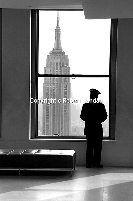 View of Empire State Building through window at the top of Rockefeller Plaza in New York City