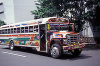 Gaudily painted public bus or Diablo Rojo on a street in Panama City, Panama