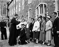 Ordinations at Maynooth College.23/06/1957..Here a newly ordained Priest is seen to bless his mother - a common scene at ordinations