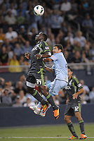 Jhon Kennedy Hurtado (34) defender Seattle Sounders wins the header..Sporting Kansas City defeated Seattle Sounders on penalty kicks, after a 1-1 tied game to win the Lamar Hunt Open Cup at LIVESTRONG Sporting Park, Kansas City, Kansas..
