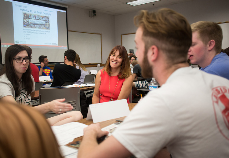 Lori Marchese helps students with a group assignment on September 24, 2015. Photo by Emily Matthews