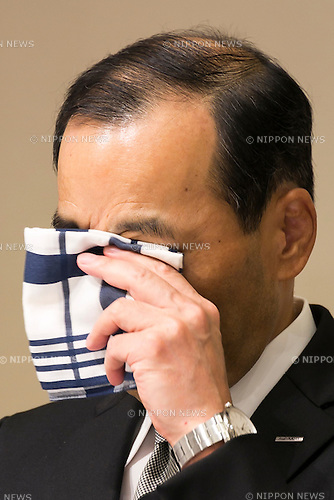 Asahi Kasei Corporation president Toshio Asano cries during a press conference on October 20, 2015, Tokyo, Japan. The Japanese construction firm apologized and answered journalists questions during a two hour conference about the involvement of subsidiary, Asahi Kasei Construction Material Corp., in defective concrete piling work and data falsification for a tilting condominium building in Yokohama south of Tokyo. Asahi Kasei will check the subsidiary's piling work data for other buildings in the past decade and has promised to rebuild the tilting apartment block. (Photo by Rodrigo Reyes Marin/AFLO)