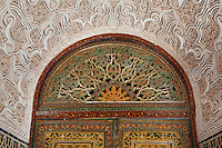 Window of the reception room in carved stucco and cedar wood, Kasbah of the Glaoua family, Telouet, High Atlas, Morocco. The fortress was begun in the 19th century as the residence Thami el Glaoui, 1879-1956, who was Pasha of Marrakech 1912-56. It sits at 1800m in the Atlas mountains on an ancient caravan route from the Sahara to Marrakech. Picture by Manuel Cohen