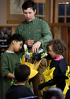 NWA Democrat-Gazette/DAVID GOTTSCHALK  Chris Anderson (left) and Aleana Gray-Smith, both third grade students at Leverett Elementary School, are dressed as a flower and bee Wednesday, March 15, 2017, as they illustrate the process of pollination with entomologist Sim Barrow, with the Northwest Arkansas Land Trust, at the Kessler Mountain Outdoor Classroom & Nature Center in Fayetteville. The students were their science curriculum. The visit also included a hike