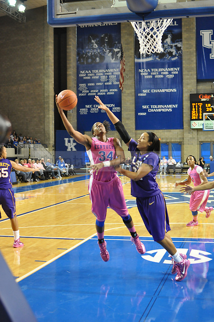 On Sunday after noon in Memorial Coliseum at 2:30pm the Kentucky Women's Basketball faced LSU. Victoria Dunlap broke through two defenders in order to complete her lay up.