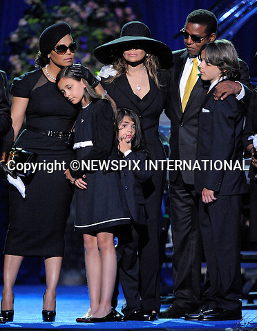 """JANET JACKSON - Is she the new stepmom?.It was very much in evidence how aunt Janet Jackson took control of the situation when Paris Jackson, Michael daughter broke down in tears while paying a tribute to her father..Her maternal instinct appeared to go into action, with a big hug for the little girl. Prince Michael l too cuddled up to her. .During the memorial Janet cuddled both Paris and Prince Michael ll..With the their grandmother considered too old at 79-years-old to be their guardian, the coming weeks will tell whether Janet has indeed stepped in..Michael Jackson Memorial, Staples Center, Los Angeles_07/07/2009.Mandatory Photo Credit: ©MJP/Newspix International..**ALL FEES PAYABLE TO: """"NEWSPIX INTERNATIONAL""""**..PHOTO CREDIT MANDATORY!!: NEWSPIX INTERNATIONAL(Failure to credit will incur a surcharge of 100% of reproduction fees)..IMMEDIATE CONFIRMATION OF USAGE REQUIRED:.Newspix International, 31 Chinnery Hill, Bishop's Stortford, ENGLAND CM23 3PS.Tel:+441279 324672  ; Fax: +441279656877.Mobile:  0777568 1153.e-mail: info@newspixinternational.co.uk"""