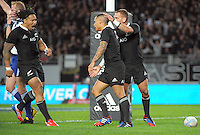 Ma'a Nonu and Aaron Cruden congratulate Aaron Smith on his try during the international rugby match between the New Zealand All Blacks and France at Eden Park, Auckland, New Zealand on Saturday, 8 June 2013. Photo: Dave Lintott / lintottphoto.co.nz