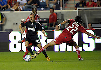 AC Milan midfielder Cristian Brocci (88) evades a challenge by Chicago Fire defender Wilman Conde (22).  AC Milan defeated the Chicago Fire 1-0 at Toyota Park in Bridgeview, IL on May 30, 2010.