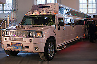 Moscow, Russia, 25/10/2009..A Hummer SUV converted into a stretch limousine with bars, dancing pole and high-end entertainment systems, at the Millionaire Fair in Moscow.The event has become an annual fixture, attracting thousands of would-be and existing Russian millionaires to view and purchase a wide range of luxury goods. This year however the fair was much smaller, an indication of how the formerly booming Russian economy has been hit by the world financial crisis.