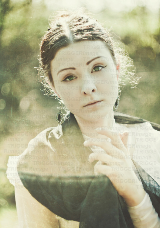 atmospheric photo of beautiful young caucasian woman looking up in retro style with big green eye