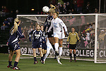 04 December 2009: Notre Dame's Lauren Fowlkes (9) and North Carolina's Amber Brooks (22) challenge for a header. The University of North Carolina Tar Heels defeated the Notre Dame University Fighting Irish 1-0 at the Aggie Soccer Complex in College Station, Texas in an NCAA Division I Women's College Cup Semifinal game.