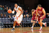 Nov 6, 2010; Charlottesville, VA, USA; Virginia Cavaliers f Akil Mitchell (25) dribbles the ball Saturday afternoon in exhibition action at John Paul Jones Arena. The Virginia men's basketball team recorded an 82-50 victory over Roanoke College.