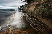 A small waterfall at Lake Superior at Pictured Rocks National Lakeshore near Munising Michigan on Michigan's Upper Peninsula.