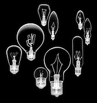 X-ray image of nine incandescent bulbs (white on black) by Jim Wehtje, specialist in x-ray art and design images.