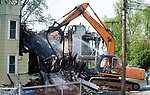 WATERBURY,  CT-051817JS20-Workers from Ocean Trace Demolition in Watertown on Thursday, tear down three of the four house destroyed by fire on Lounsbury Street  in Waterbury.  <br /> Jim Shannon Republican-American